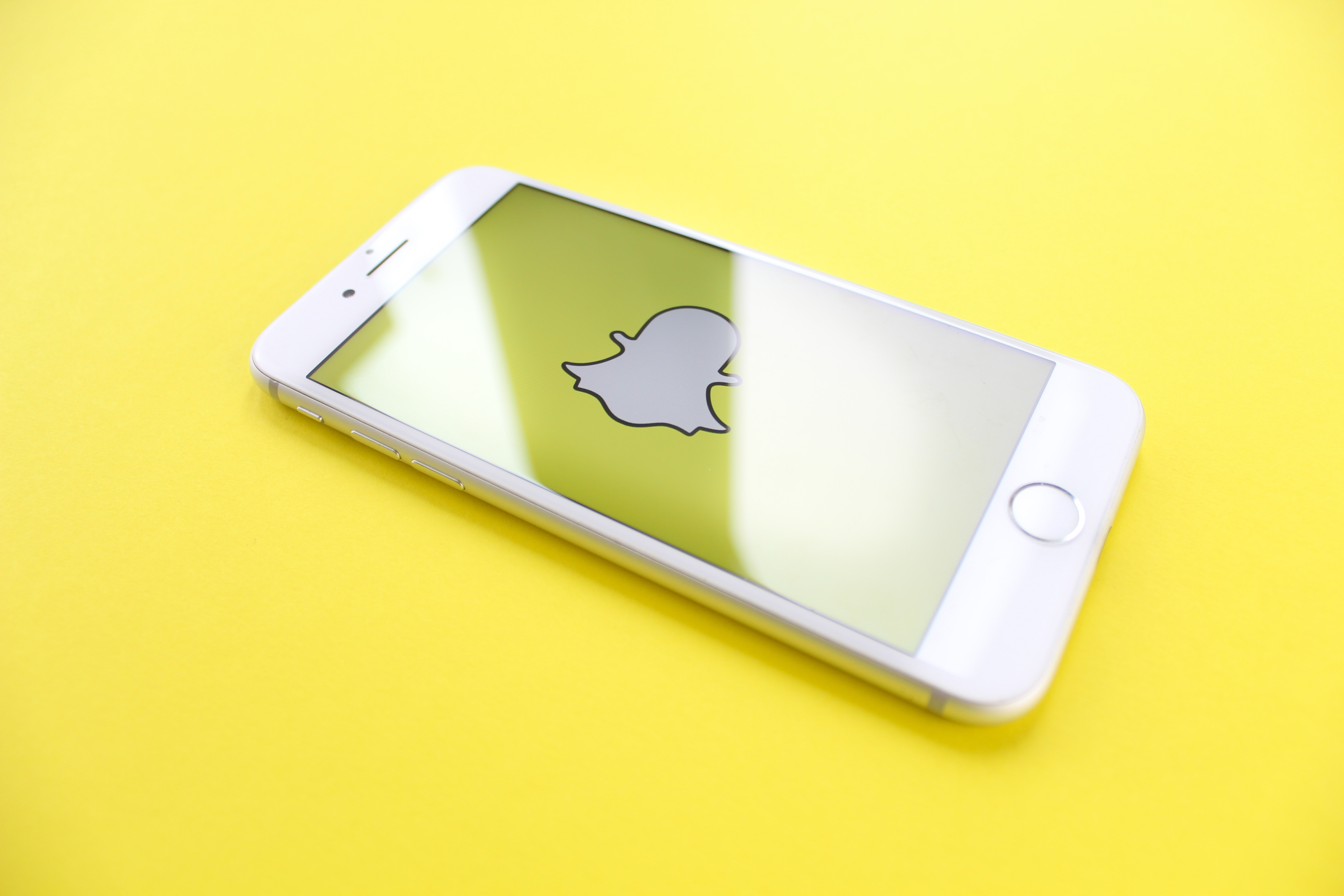 Snapchat on iPhone with yellow background