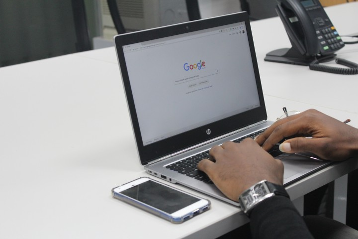 laptop on table with google search